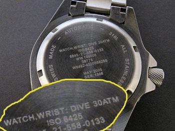 Надпись ISO задней крышке на часов